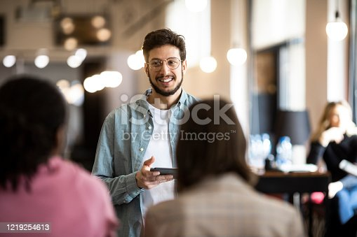 603992132 istock photo Happy Young Businessman Giving his Team a Business Presentation by Using a Tablet 1219254613