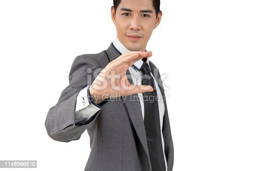 Happy young businessman in suit looking at camera on white background, isolated concept