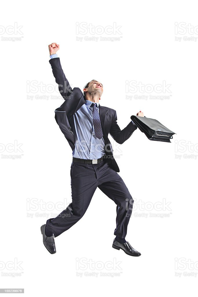 Happy young businessman jumping in the air royalty-free stock photo