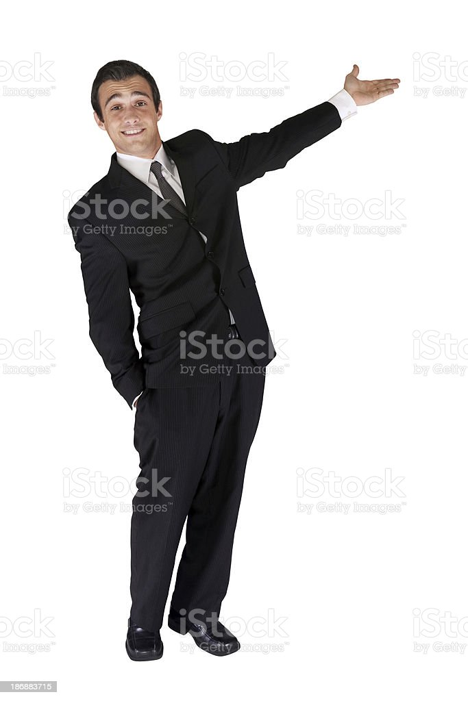 Happy young businessman presenting stock photo