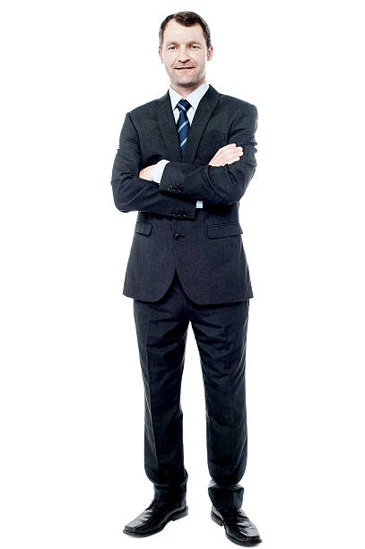 Happy young businessman smiling stock photo