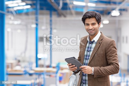 istock Happy young businessman with digital tablet in warehouse 536051931