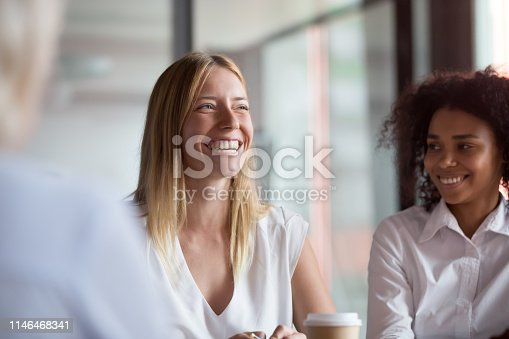 istock Happy young businesswoman coach mentor leader laughing at group meeting 1146468341