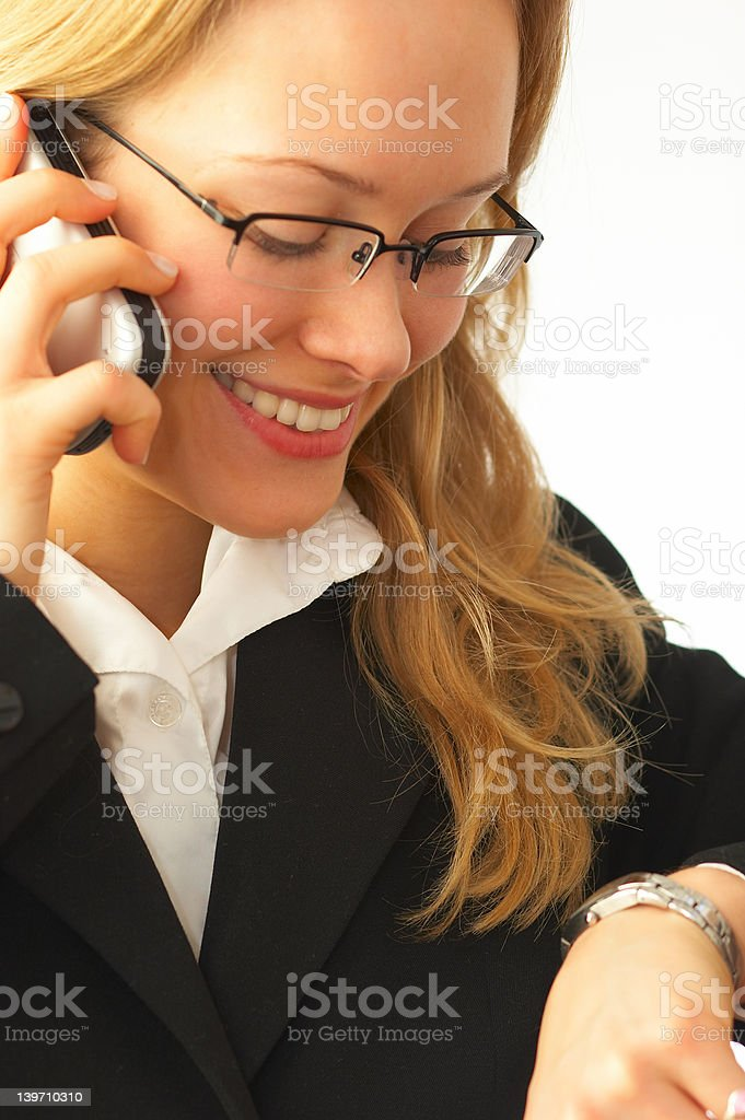 Happy young businesswoman making a call royalty-free stock photo