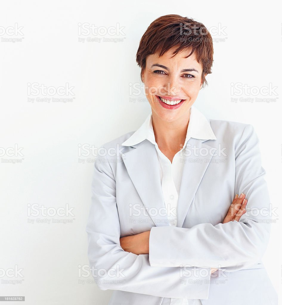 Happy young businesswoman posing royalty-free stock photo
