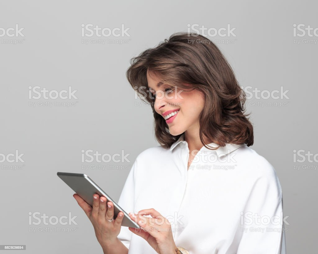 Happy young businesswoman using a digital tablet - Royalty-free 25-29 Years Stock Photo