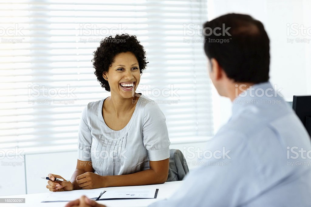Happy young businesswoman with her colleague royalty-free stock photo