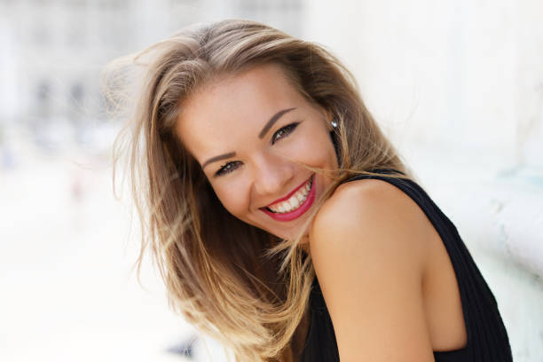 Happy young carefree woman smiling outdoor portrait stock photo