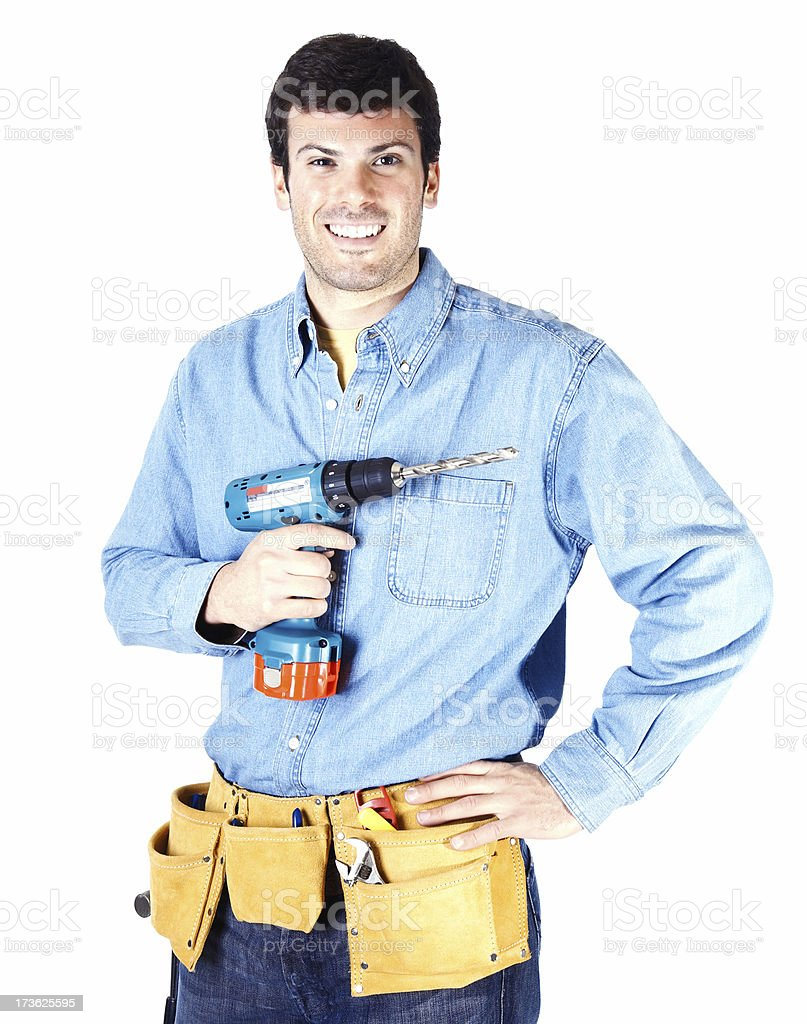 Happy young carpenter holding hand drill royalty-free stock photo