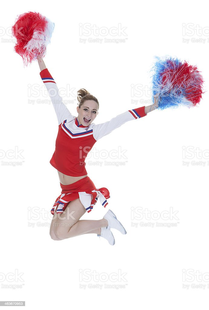 Happy Young Cheerleader Jumping With Pom-poms royalty-free stock photo