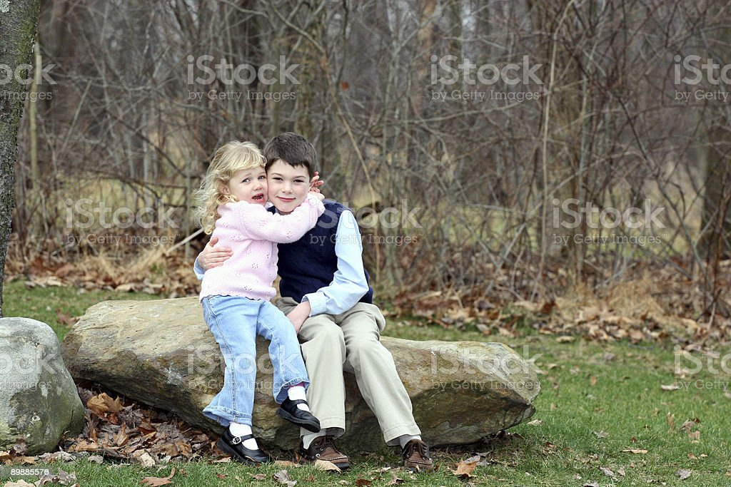 Happy Young Children Siblings (4) Hugging royalty-free stock photo