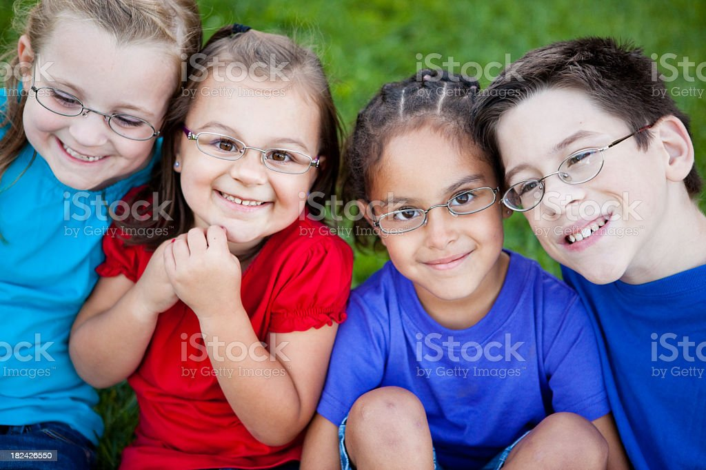 Happy Young Children with Glasses Smiling Outside royalty-free stock photo