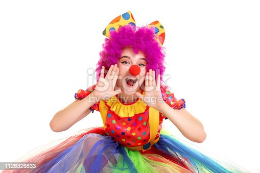 Happy young clown girl on white background.