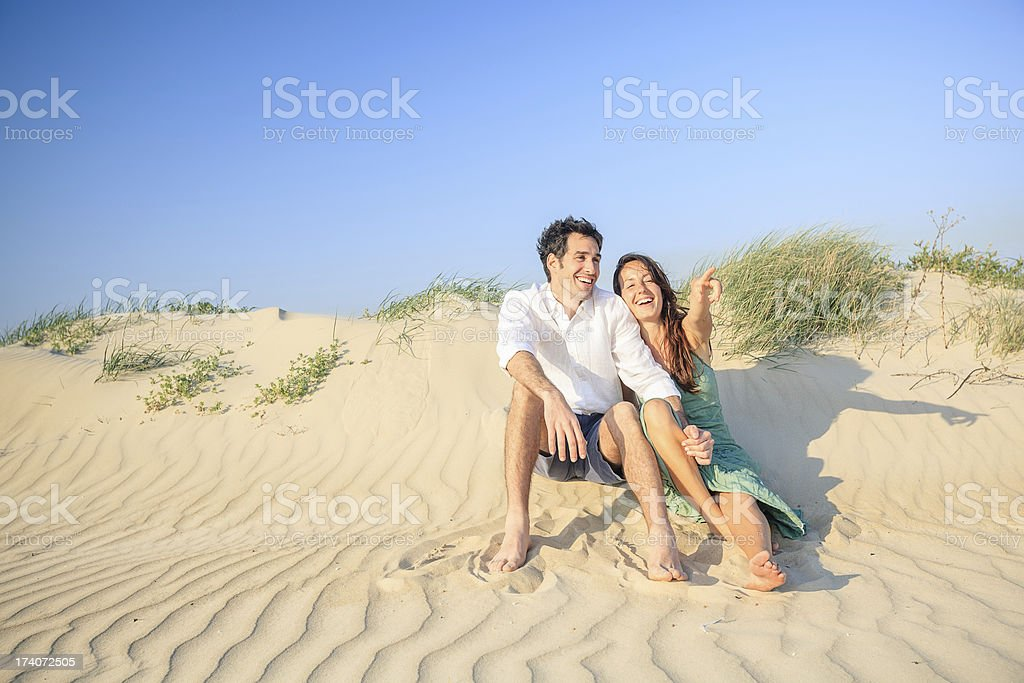 Happy young couple at beach royalty-free stock photo