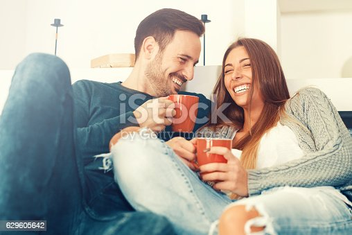 istock Happy young couple at home 629605642