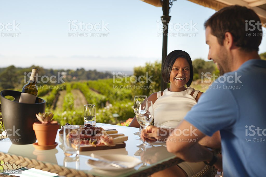 Happy young couple at winery restaurant stock photo