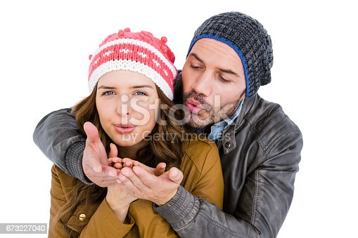 673176670 istock photo Happy young couple blowing kiss 673227040