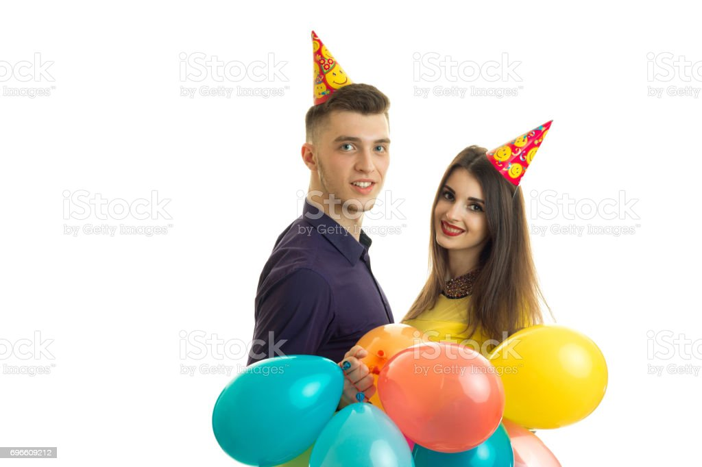 happy young couple celebrate a birthday party with balloons in hands stock photo