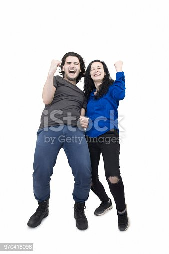 854381886 istock photo Happy young couple cheering over white background 970418096