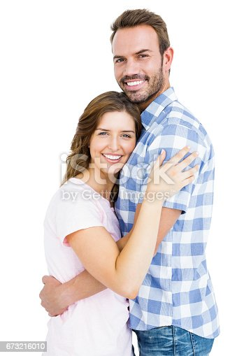 673176670 istock photo Happy young couple cuddling each other 673216010