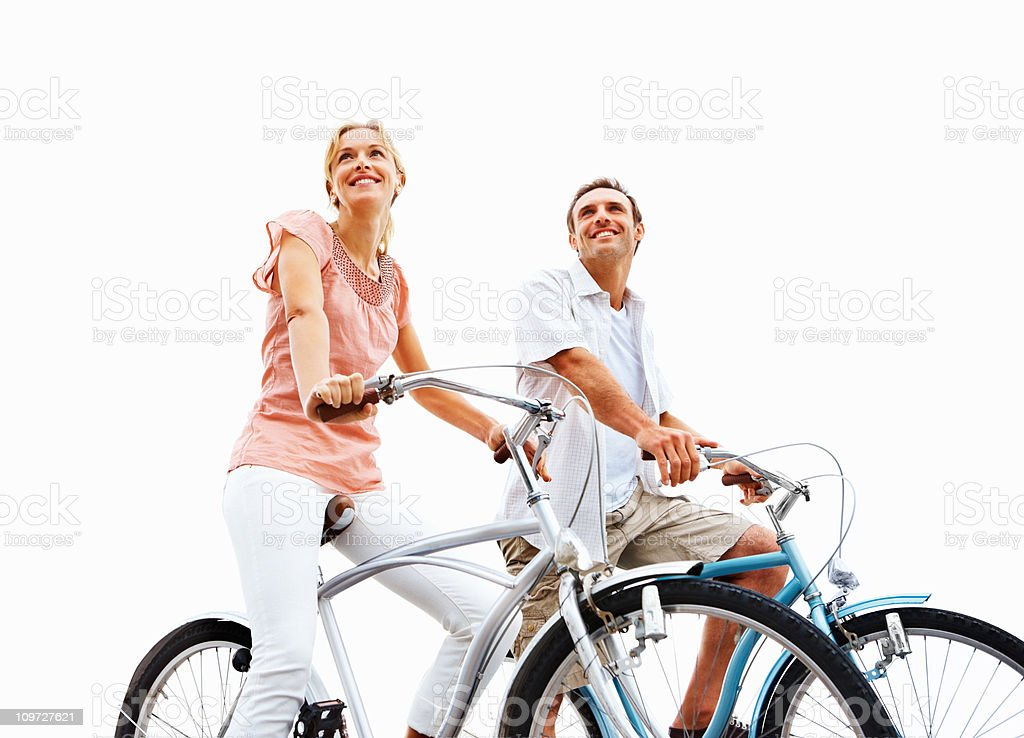 Happy young couple cycling royalty-free stock photo