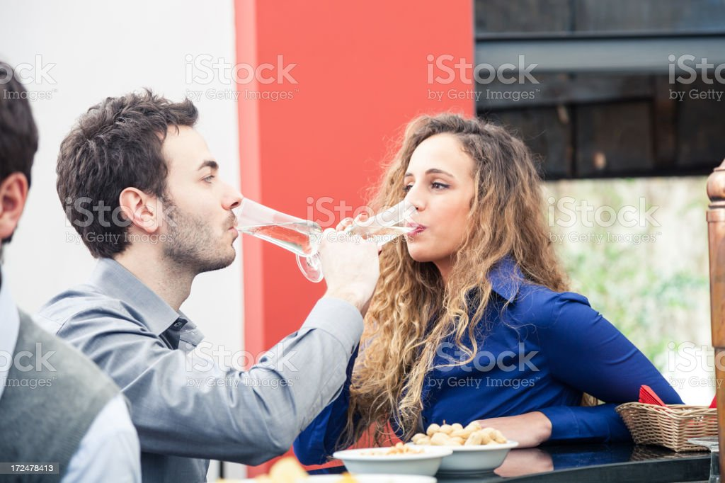 Happy young couple drinking together stock photo