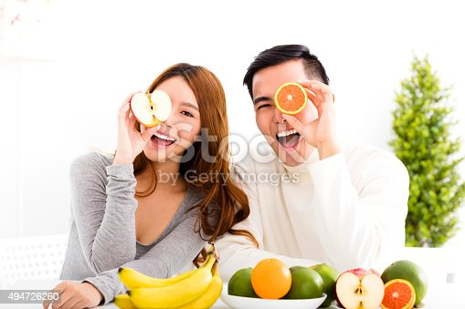 istock happy Young couple eating fruit and healthy food 494726260