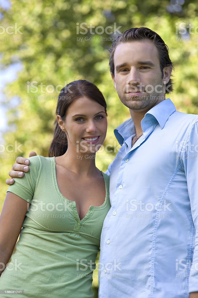 Happy young couple embracing each other stock photo