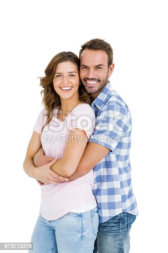 673176670 istock photo Happy young couple embracing 673213318