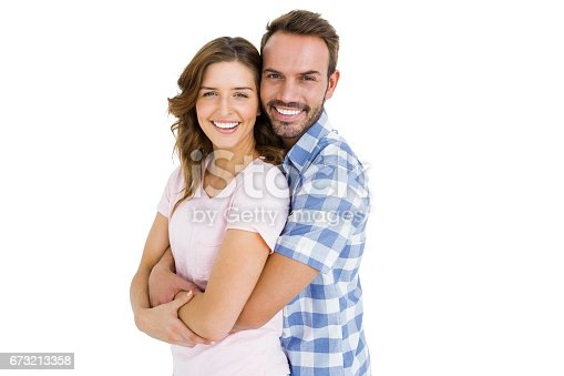 673176670 istock photo Happy young couple embracing 673213358