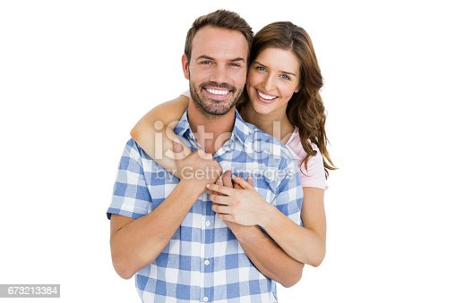 673176670 istock photo Happy young couple embracing 673213384