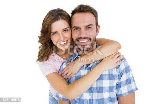 673176670 istock photo Happy young couple embracing 673215578