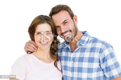 673176670 istock photo Happy young couple embracing 673215888