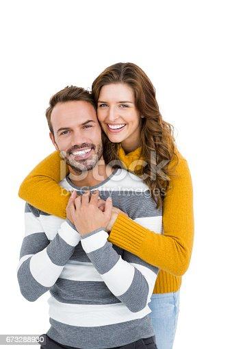 673176670 istock photo Happy young couple embracing 673288930