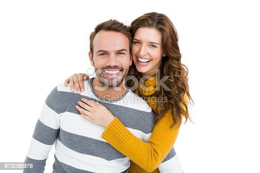 673176670 istock photo Happy young couple embracing 673288976