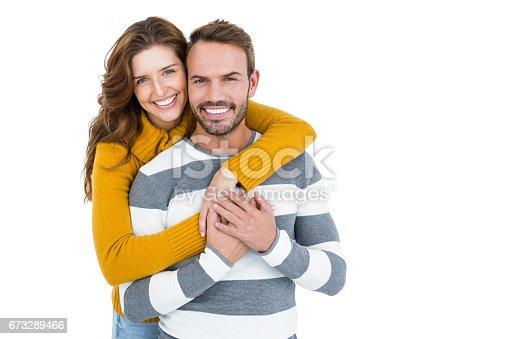 673176670 istock photo Happy young couple embracing 673289466