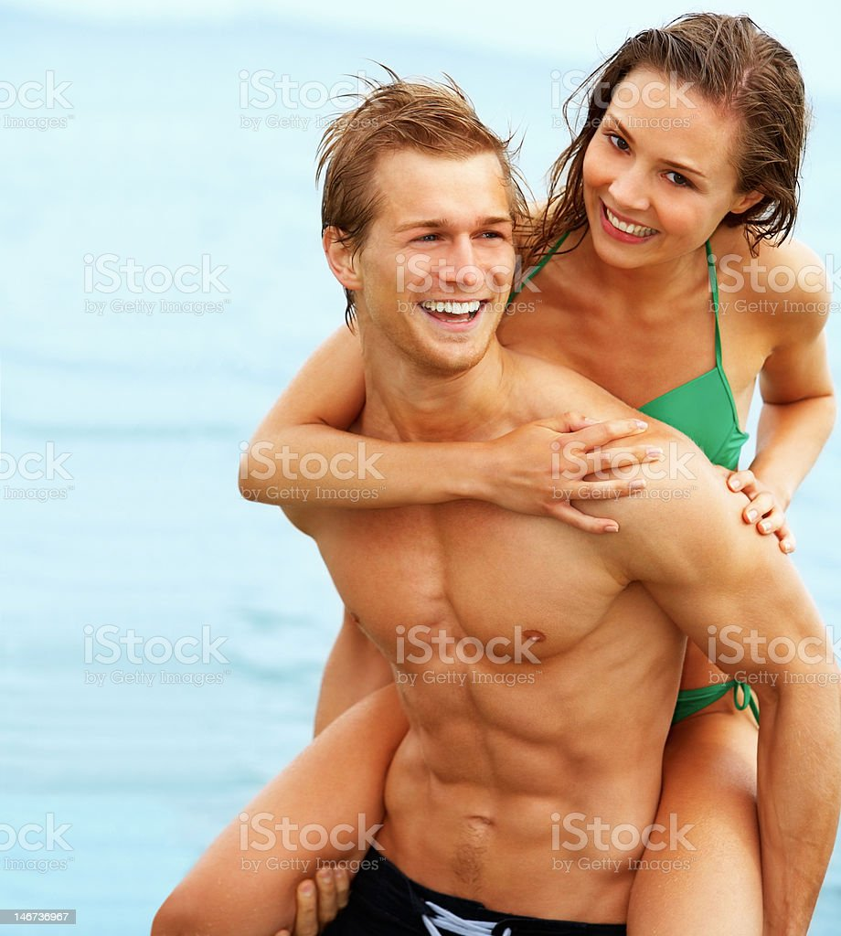 Happy young couple enjoying at beach royalty-free stock photo