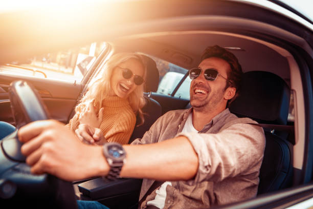 Happy young couple enjoying in drive Happy young couple enjoying on a long drive in a car. car stock pictures, royalty-free photos & images