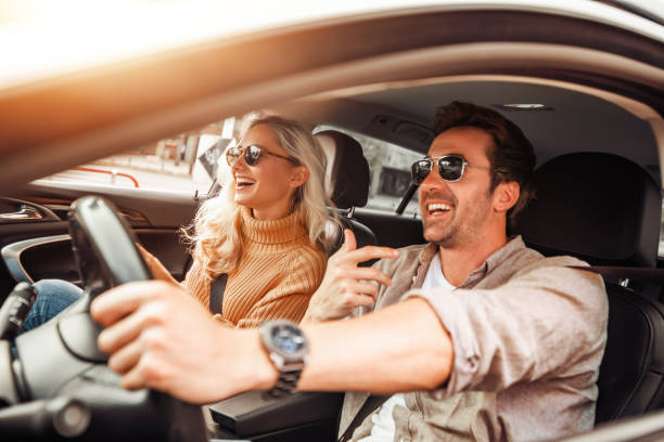 Happy young couple enjoying in drive stock photo