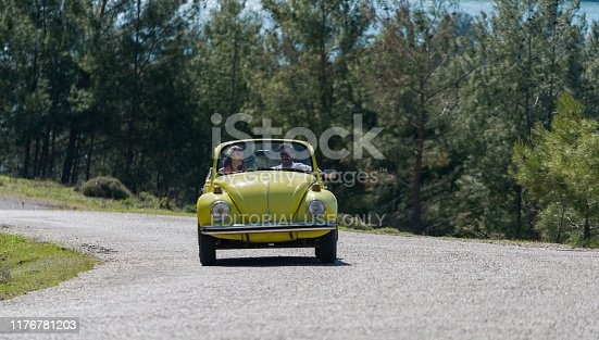 Antalya, Turkey - April 9, 2017 Happy young couple enjoying in drive with Volkswagen Beetle