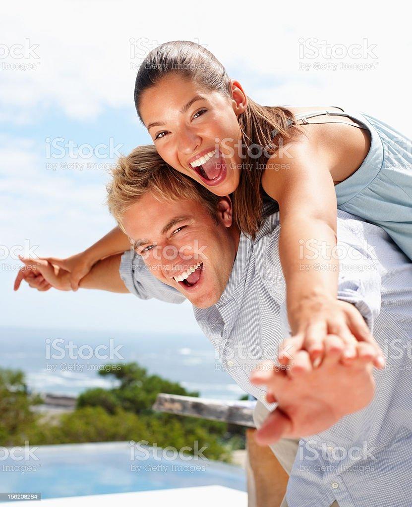 Happy young couple enjoying outdoors royalty-free stock photo