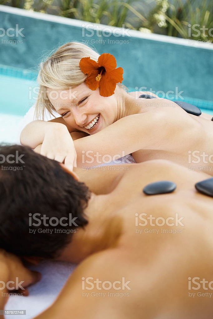Happy young couple enjoying their hot stone therapy royalty-free stock photo