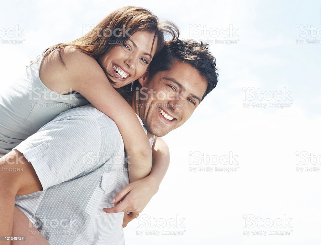 Happy, young couple enjoying their vacation stock photo