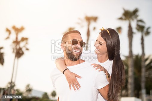 Happy young couple falling in love on sunset on Cyprus island.