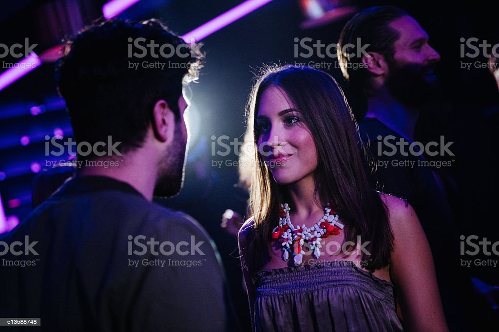 Happy young couple flirting in a night club - Royalty-free 20-29 Years Stock Photo