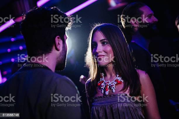 Happy young couple flirting in a night club picture id513588748?b=1&k=6&m=513588748&s=612x612&h=kzfwjcm8m hggnyqmu7zpfvjlbvayrqevwvna59rzys=