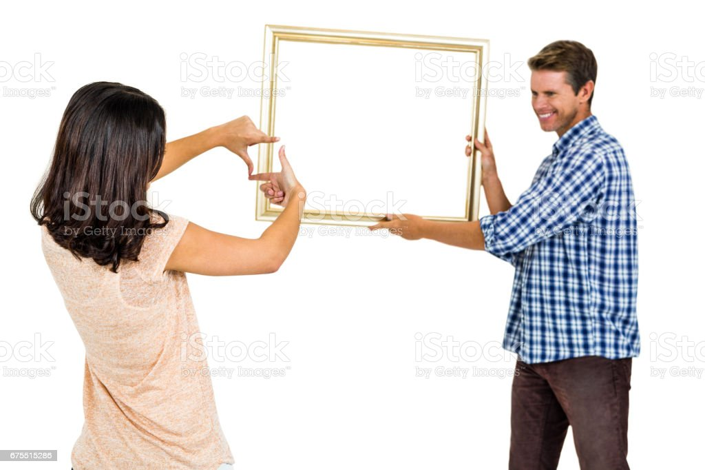 Mutlu genç çift resim çerçevesi asılı royalty-free stock photo