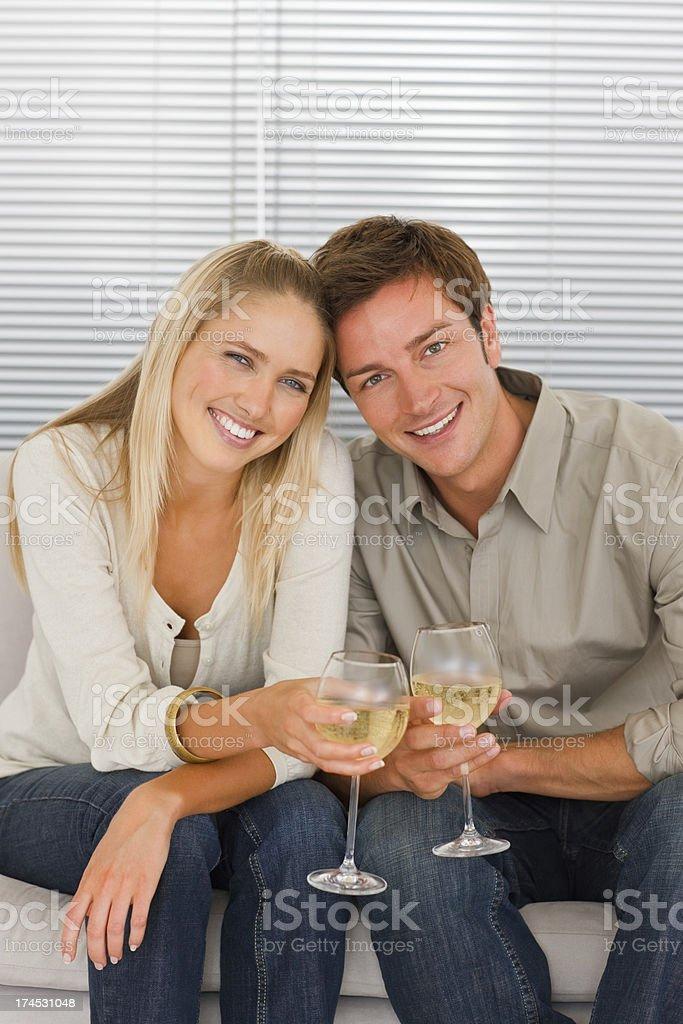 Happy young couple having celebration royalty-free stock photo