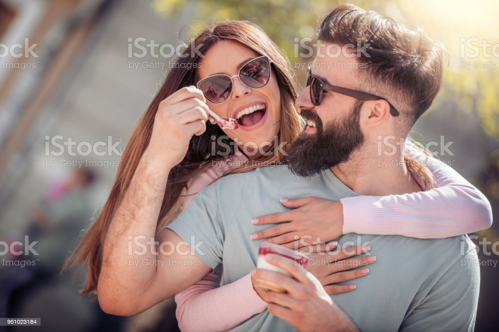 Happy young couple having fun outdoors and smiling stock photo