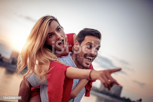 1069131934 istock photo Happy young couple having fun outdoors 1043066166
